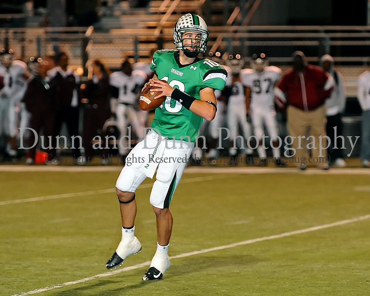 -Carroll quarterback prepares to pass in Carroll's 45-10 victory over Lewisville last Friday night at Dragon Stadium.