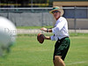 Carroll head coach Hal Wasson throws a pass during Monday's two-a-day practice.