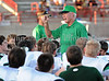 Carroll head coach Hal Wasson talks to his team prior to the scrimmage against Duncanville last Friday night at Panther Stadium.