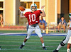 Carroll quarterback Daxx Garman (wearing a red practice jersey for protective reasons) prepares to throw a pass in the scrimmage against Duncanville last Friday night at Panther Stadium.
