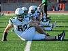 #53 and teammates warm up prior to the scrimmage against Duncanville last Friday night at Panther Stadium.