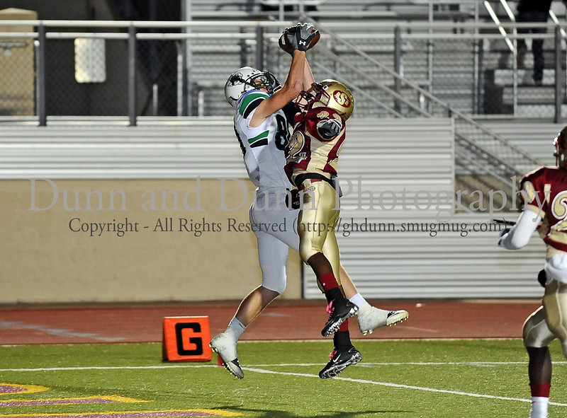 Carroll wide receiver Dylan Alexander catches the ball for a touchdown over a Saginaw defender for the second of his two touchdowns in Carroll's 59-0 win over Saginaw at Rough Rider Stadium last Friday night.