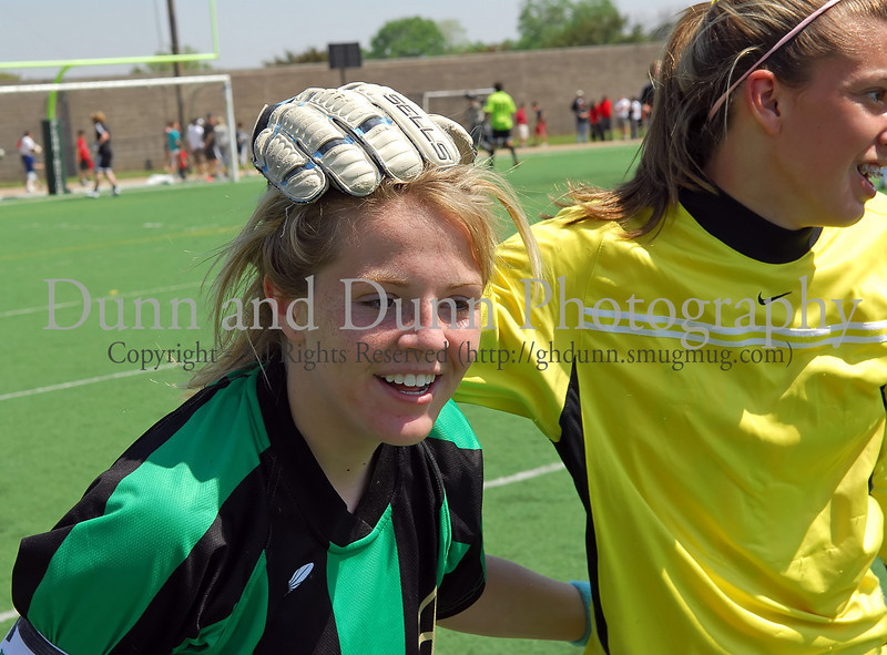Carroll junior Lexis Learmonth is congratulated by goalie Caitlin Schneider following Learmonth's winning goal in the shoot out at the end of the regional final against Hebron last Saturday afternoon at Pennington Field.