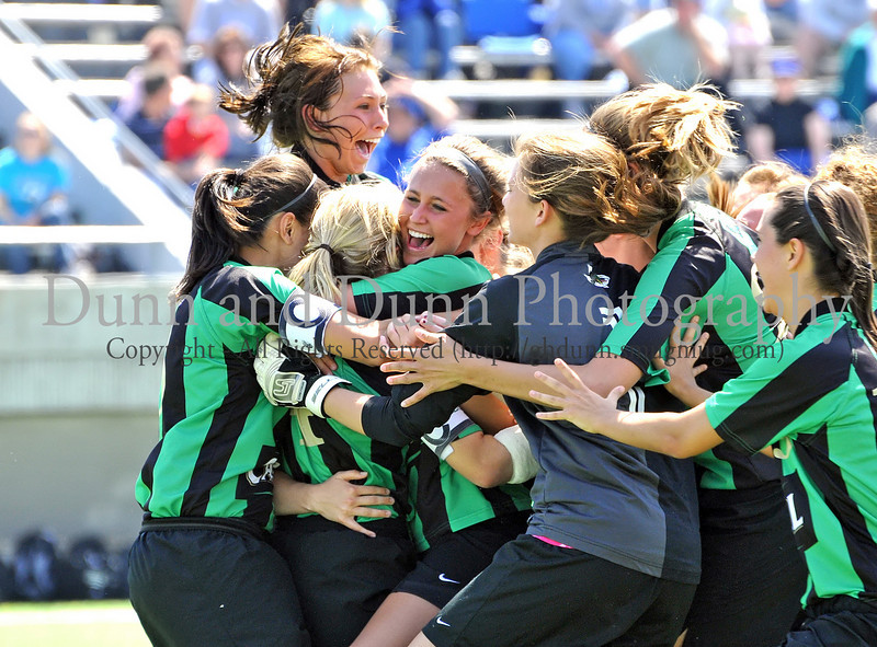 Carroll junior Lexis Learmonth is congratulated by her teammates following her winning goal in the shoot out at the end of the regional final against Hebron last Saturday afternoon at Pennington Field.