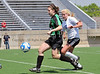Carroll senior defender Ally Hunter Crocco advances the ball in the regional final against Hebron last Saturday afternoon at Pennington Field.  Hebron's Kelsey Blincow defends on the play.