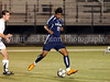 FMM - Flower Mound senior Carlos Castro passes the ball in the game against Carroll last Friday night at Dragon Stadium.