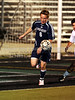 FMM - Flower Mound junior Nathan Rablee goes for the ball in the game against Carroll last Friday night at Dragon Stadium.