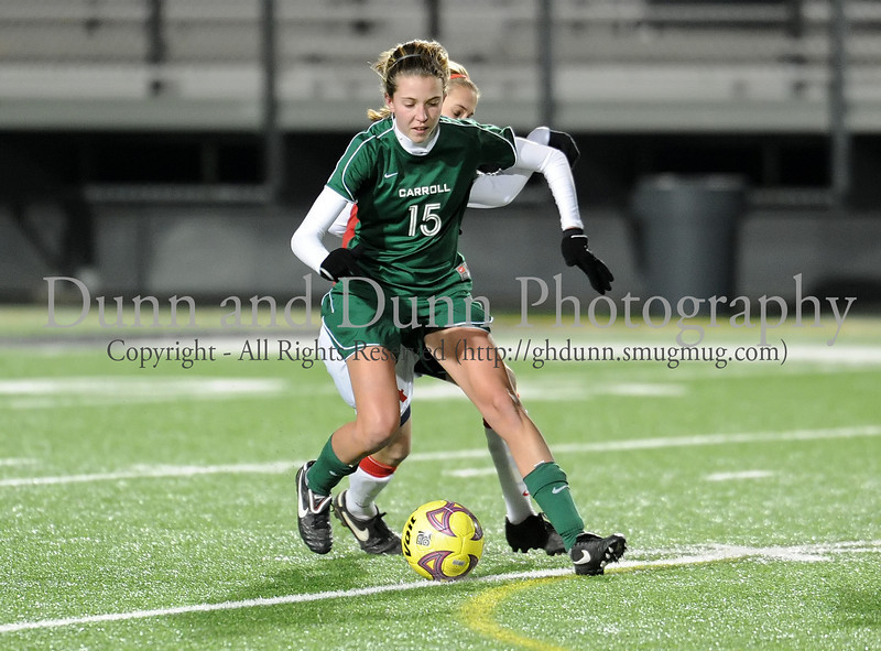 Carroll sophomore midfielder Cristina Petrovich shields the ball during Monday night's scrimmage against Grapevine at Dragon Stadium.