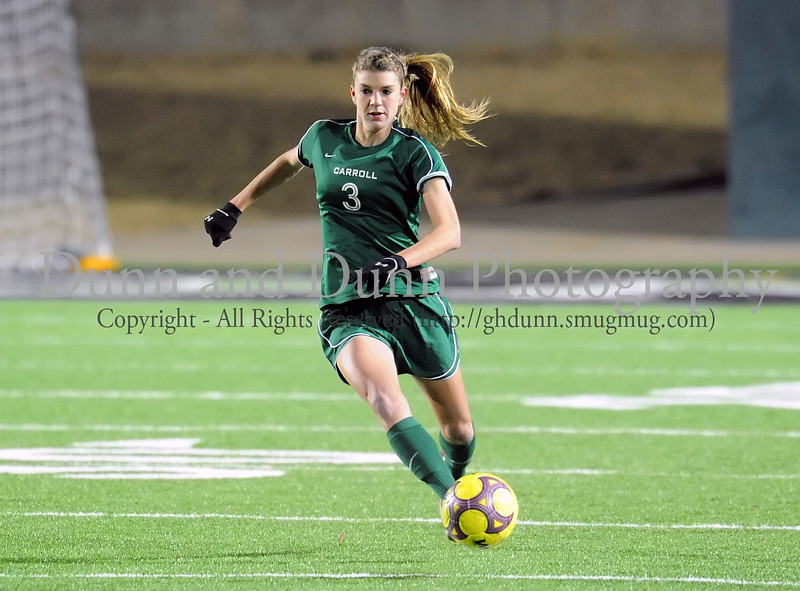 Carroll junior defender Taylor Schneider advances the ball during Monday night's scrimmage against Grapevine at Dragon Stadium.