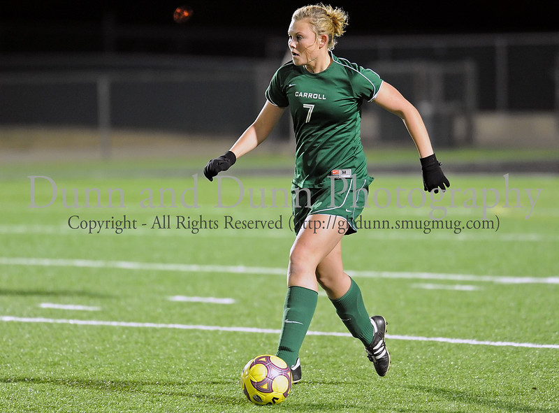 Carroll senior forward Claire Manning advances the ball during Monday night's scrimmage against Grapevine at Dragon Stadium.
