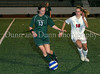Carroll freshman defender Ashlea Marler (#13) takes the ball away from a Graepvine player.  Carroll's defense held Grapevine to a single goal.