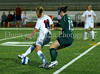 Carroll junior defender Alyssa Nelson (#18) blunts a Grapevine attack.