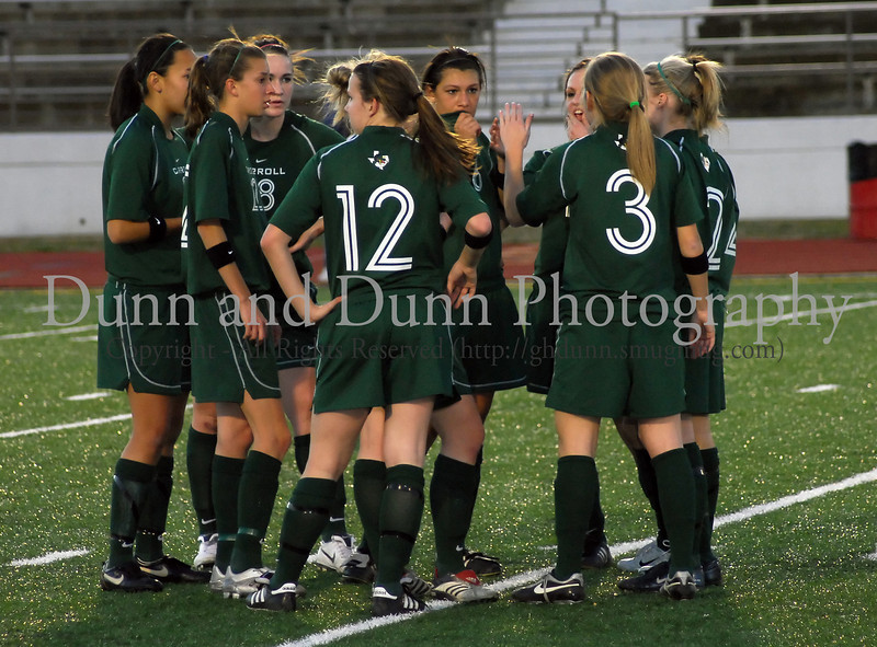 Carroll's starters confer prior to the start of the game against Grapevine on February 20,2007.