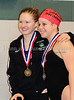 Carroll sophomore Claire Singley and senior  Lisa Ginder on the awards stand following their awards for first and second, respectively, in the 500 Yard Freestyle at the District 8-5A Championships at Carroll Senior High School on Saturday, January 25, 2008.