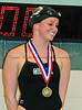 Carroll senior Leah Cowperthwaite with  her first place medal for winning the 100 Yard Freestyle at the District 8-5A Championships at Carroll Senior High School on Saturday, January 25, 2008.