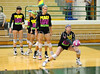 Senior Sally Johnsen and other members of the Carroll varsity volleyball team warm up prior to Tuesday night's match with Allen at Carroll Senior High School.