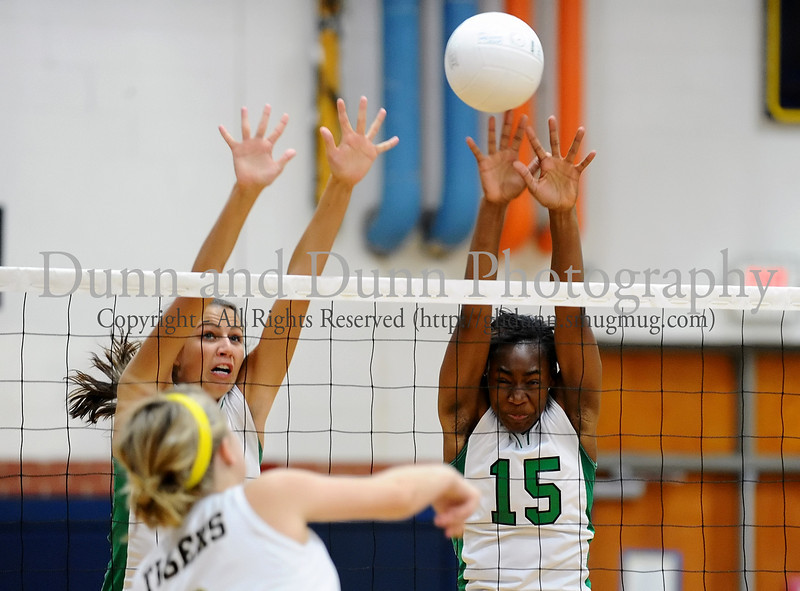 Carroll's Olivia Miano and Janelle Jenkins get a block in the game against Mansfield High School as a part of last Saturday's Arlington Invitational Tournament.