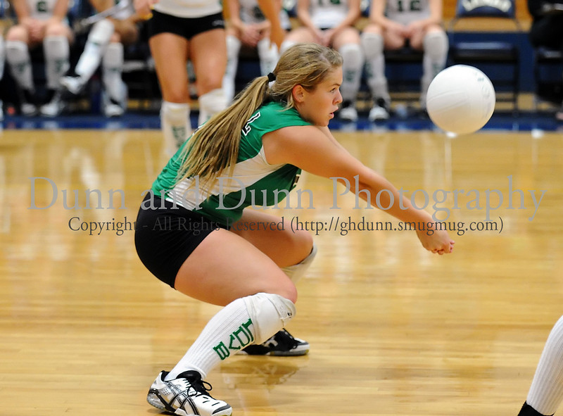 Carroll libero Caitlin Nolan gets a dig in the game against Mansfield High School as a part of last Saturday's Arlington Invitation Tournament.
