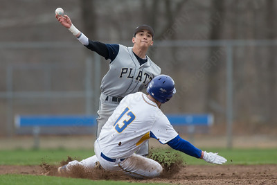 Platt's Mikey Rojas tags Wilcox Tech's Matt Ryan out at second and throws to first for the double play Friday at Legion Field in Meriden Apr. 8, 2016 | Justin Weekes / For the Record-Journal