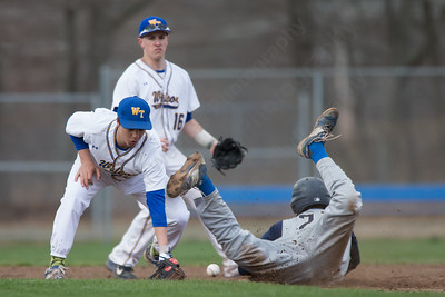 Platt's Jeff Morales slides into second beating the throw to Wilcox Tech's Vincent Verlezza Friday at Legion Field in Meriden Apr. 8, 2016 | Justin Weekes / For the Record-Journal