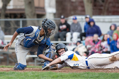 Platt's catcher Jaff Morales tags out Wilcox Tech's Breydan Kennedy at home Friday at Legion Field in Meriden Apr. 8, 2016 | Justin Weekes / For the Record-Journal