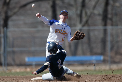 Wilcox Tech's James Theriault turns the double play Saturday at Legion Field in Meriden April 7, 2018 | Justin Weekes / Special to the Record-Journal