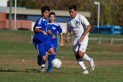 Wilcox Tech's Kelvin Cortez pushes past a defender Tuesday during the quarterfinal round in the CTC tournament at Wilcox Tech in Meriden October 31, 2017 | Justin Weekes / For the Record-Journal