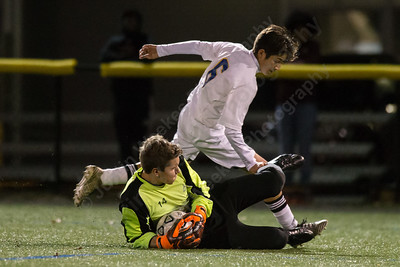 University's goalie K'ser Htoo cuts off Wilcox Tech's Andres Farfan Saturday during the CTC conference championship at Cheney Tech in Manchester November 4, 2017 | Justin Weekes / For the Record-Journal