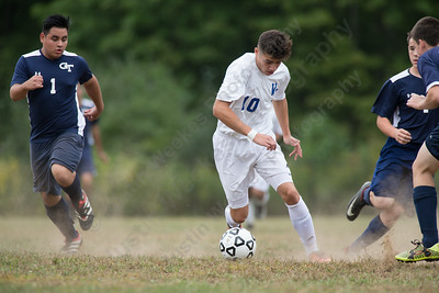 Wilcox Tech's Jaden Myles dibbles the ball in traffic Monday at Wilcox Tech in Meriden September 18, 2017 | Justin Weekes / For the Record-Journal