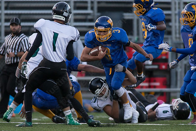 Wilcox Tech's Aden Valentin fights for extra yards Saturday at Falcon Field in Meriden Sep. 24, 2016   Justin Weekes / For the Record-Journal