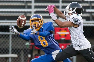 Wilcox Tech's David Vasquez reaches for a pass as Crec's Carlos Rico covers Saturday at Falcon Field in Meriden Sep. 24, 2016 | Justin Weekes / For the Record-Journal