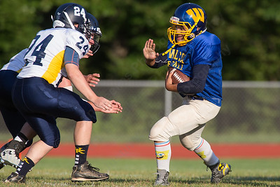 Wilcox Tech's Steven Ortiz runs as HK's Jarrett Lemon lines up for a tackle Wednesday during a scrimmage at Haddam Killingworth in Higganum Aug. 24, 2016 | Justin Weekes / For the Record-Journal