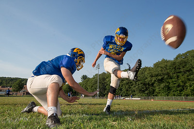 Wilcox Tech's Derek Gendreau hold for kicker Tyler Strickland Wednesday during a scrimmage at Haddam Killingworth in Higganum Aug. 24, 2016 | Justin Weekes / For the Record-Journal