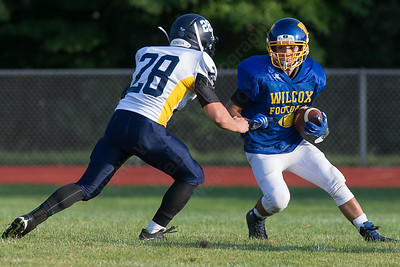 Wilcox Tech's Aden Valentin tries to beat HK's Trevor Brochu Wednesday during a scrimmage at Haddam Killingworth in Higganum Aug. 24, 2016 | Justin Weekes / For the Record-Journal
