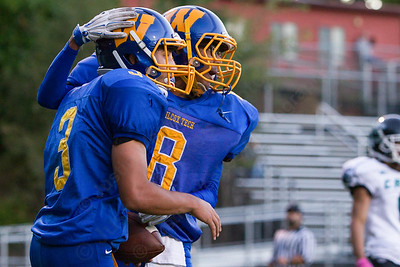 Wilcox Tech's Aden Valentin and David Vasquez celebrate after Valentin's touchdown Saturday at Falcon Field in Meriden Sep. 24, 2016   Justin Weekes / For the Record-Journal