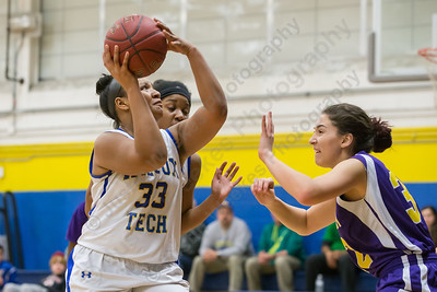 Wilcox Tech's Sharae Henderson puts up a shot as Prince Tech's Karla    Perez defends Wednesday at Wilcox Tech in Meriden Feb. 10, 2016 | Justin Weekes / For the Record-Journal