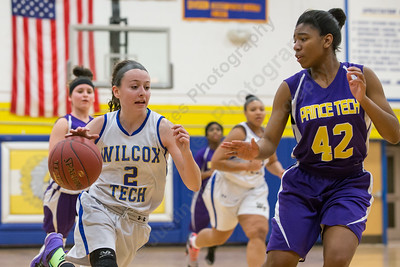 Wilcox Tech's Samantha Petro drive to the basket as Prince Tech's Omyra Lockhart defends Wednesday at Wilcox Tech in Meriden Feb. 10, 2016 | Justin Weekes / For the Record-Journal