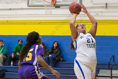 Wilcox Tech's Rhaelene Hastings puts in a layup as Prince Tech's Nande Jones  defends Wednesday at Wilcox Tech in Meriden Feb. 10, 2016 | Justin Weekes / For the Record-Journal