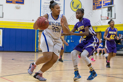 Wilcox Tech's Sharae Henderson works past Prince Tech's Shania Shorter  Wednesday at Wilcox Tech in Meriden Feb. 10, 2016 | Justin Weekes / For the Record-Journal