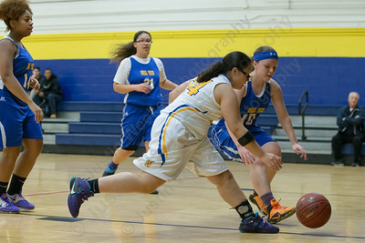 Wilcox Tech's Jocelyn Pagan and Vinal Tech's Hailey Fowler chase a loose ball Tuesday at Wilcox Tech High School in Meriden Jan. 3, 2017 | Justin Weekes / For the Record-Journal