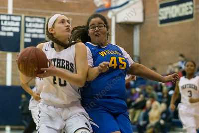Platt's Julia Misner drives as Wilcox Tech's Rhaelene Hastings defends Tuesday at Platt High School in Meriden December 19, 2017 | Justin Weekes / For the Record-Journal