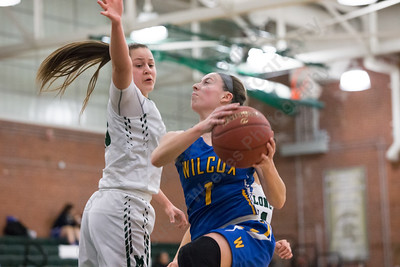 Wilcox Tech's Samantha Petro drives on Maloney's Melanie Polanco Monday at Maloney High School in Meriden January 29, 2018 | Justin Weekes / Special to the Record-Journal