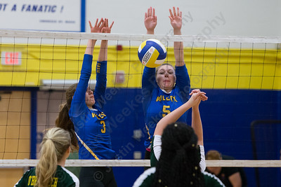 Wilcox Tech's Sara Morin and Chloe LaBissoniere jump to block a O'Brien Tech  touch Wednesday at Wilcox Tech in Meriden  September 27, 2017 | Justin Weekes / For the Record-Journal