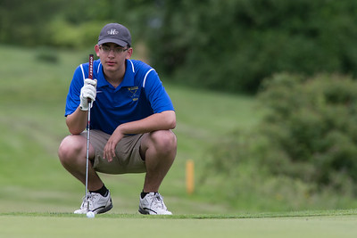 Wilcox Tech's Ryan Pellegrino crouches to read the 11th green before putting Wednesday during the Meriden City High School championship sponsored by the Hunters Mens Club at Hunters Golf Club in Meriden  May. 31, 2017 | Justin Weekes / For the Record-Journal