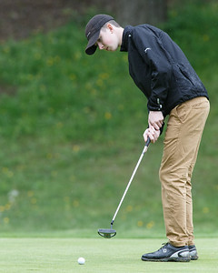 Wilcox Tech's Noah Rogala putts on the tenth green Tuesday at Hunter Golf Club in Meriden May 22, 2018 | Justin Weekes / Special to the Record-Journal