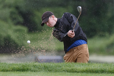 Wilcox Tech's Noah Rogala plays a shot from a green side bunker Tuesday at Hunter Golf Club in Meriden May 22, 2018 | Justin Weekes / Special to the Record-Journal