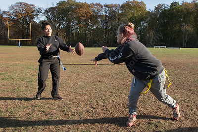 Wilcox Tech's Lexi Durand tosses to Jailene Ruiz Wednesday during Powder Puff practice at Wilcox Tech in Meriden  November 15, 2017 | Justin Weekes / For the Record-Journal