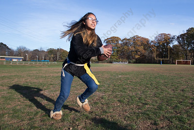 Wilcox Tech's Yami Pebe runs a play Wednesday during Powder Puff practice at Wilcox Tech in Meriden  November 15, 2017 | Justin Weekes / For the Record-Journal