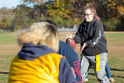 Wilcox Tech's Lexi Durand takes the snap Wednesday during Powder Puff practice at Wilcox Tech in Meriden  November 15, 2017 | Justin Weekes / For the Record-Journal