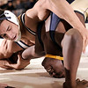 1-27-2010...189 lbs...Anthony Mordaga of Paramus (top) defeated Hackensack's Jonathan Long by a pin in 3:09<br /> PHOTO: KELLY BIRDSEYE